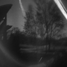 Captured with aluminum can solarography pinhole camera directly on to light sensitive paper. Two week exposure. White lines seen are the sun's daily paths.
